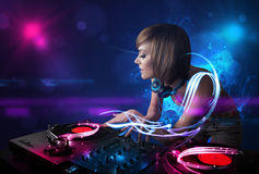Disc jockey playing music with electro light effects and lights. Beautiful disc jockey playing music with electro light effects and lights stock photography