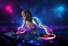 Disc jockey playing music with electro light effects and lights. Beautiful disc jockey playing music with electro light effects and lights royalty free stock images