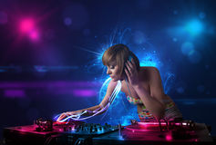 Disc jockey playing music with electro light effects and lights. Beautiful disc jockey playing music with electro light effects and lights stock images