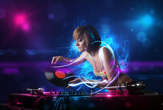 Disc jockey playing music with electro light effects and lights. Beautiful disc jockey playing music with electro light effects and lights royalty free stock photos
