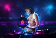 Disc jockey playing music with electro light effects and lights. Beautiful disc jockey playing music with electro light effects and lights stock photo