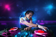 Disc jockey playing music with electro light effects and lights Royalty Free Stock Images