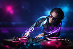 Disc jockey playing music with electro light effects and lights Royalty Free Stock Photography