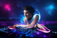 Disc jockey playing music with electro light effects and lights. Young disc jockey playing music with electro light effects and lights royalty free stock photography