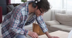 Disc jockey playing music at home