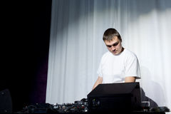 Disc jockey preparing his equipment Stock Image