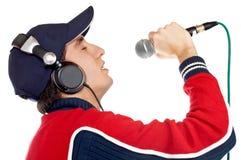 Disc jockey singing. Disc jockey with headphones singing on white background stock image
