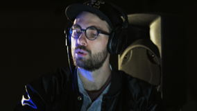 Disc Jockey Using Headphones and Dancing. DJ prepares to a party. Close-up. Shot on RED Epic stock video