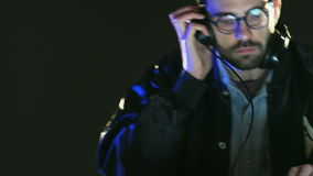 Disc Jockey Using Headphones and Listening to Music. DJ prepares to a party. Close-up. Shot on RED Epic stock video footage
