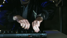Disc Jockey Using Headphones and Listening to Music. DJ prepares to a party. Close-up. Shot on RED Epic stock footage