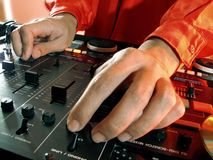 Disc Jockey at work. Working Disc jockey at party. Detail of a dj hands stock photography