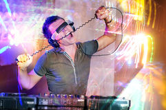 Disc Jockey. Work with electronic mixer and mixing records at night club royalty free stock image