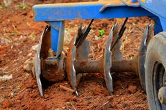 Disc plow, disc harrow. Farm implement used to till the soil before the crops ate to be planted Stock Photography