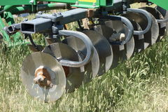 A disc plow in use at a farm in idaho Stock Photos