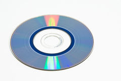 Disc with reflection. Blue compact disc with colorful reflection on white Stock Photos