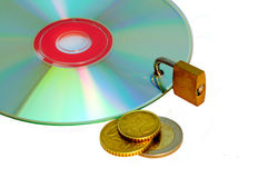 Disc under lock and key and money. Isolated on a white background Royalty Free Stock Images