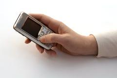 Discando um telefone de pilha Imagem de Stock Royalty Free