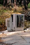 Discard TV sets on street, television near container thrown. Discard old TV sets on a street, television near the container thrown, the natural environment. A TV Royalty Free Stock Images