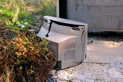 Discard TV sets on street, television near container thrown. Discard old TV sets on a street, television near the garbage container thrown, natural environment Royalty Free Stock Photos
