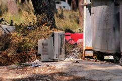 Discard TV sets on street, television near container thrown. Discard old TV sets on a street, television near the container thrown, the natural environment. A TV Stock Photo