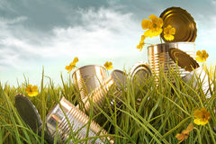 Discarded aluminium cans in tall grass Stock Photography