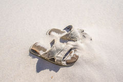Discarded Beach Sandals stock photography