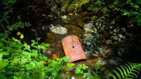 Discarded brown rusty metal drum. Stock Image
