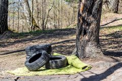 Discarded car tires in nature. Environmental pollution royalty free stock photos