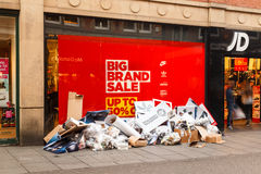 Discarded Christmas POS outside JD Sports as Boxing Day sales st Royalty Free Stock Photography