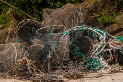 Discarded crab traps and fishing nets Royalty Free Stock Photos
