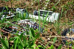 Discarded electronic. Appliances free standing in nature stock photos