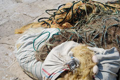 Discarded Fishing Nets. The smell of day old fish led me to this pile of discarded fishing nets on pier in Corfu, Greece royalty free stock photos