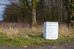 """Discarded Fridge in Nature. A discarded fridge on the East Yorkshire Wolds, with the comment """"Which idiot dumps on our lovely Yorkshire Wolds"""" royalty free stock photo"""