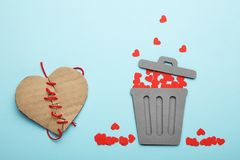 Discarded heart and relationship in couple. Red broken hearts in trash can stock photo