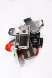 Discarded mobile phones. A pile of discarded mobile phones with white background royalty free stock photography