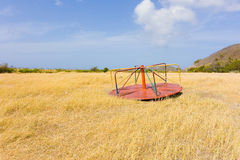 Discarded playground apparatus in an overgrown field on bequia Stock Photography