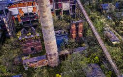 Discarded power plants. In the old generation of power plants, after abandonment, there were many plants, iron stains and different colors Royalty Free Stock Photo