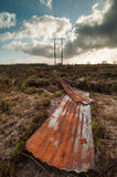 Discarded rusty corrugated iron in a peat bog field Royalty Free Stock Image