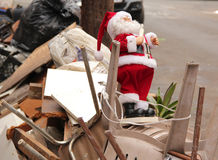 Discarded Santa Claus. Santa Claus toy is left with the trash Royalty Free Stock Photo