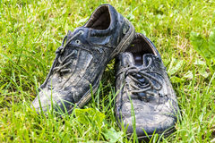 Discarded shoes in the grass Royalty Free Stock Photo
