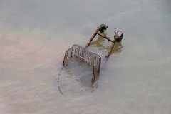 Discarded shopping trolley in water. Royalty Free Stock Image