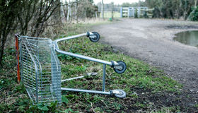 Discarded supermarket trolley Royalty Free Stock Image
