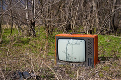 Discarded television set in the forest Royalty Free Stock Images