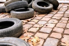 Discarded tires. A discarded tires on flagging in a city royalty free stock photos