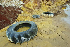 Discarded tires. Old discarded tires in the kaolin mine royalty free stock images