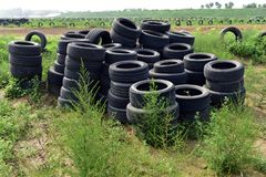 Discarded tires. A lot of discarded tires are next to the track stock photography