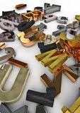 Discarded type. 3D render of letters in various typefaces and metals Stock Image
