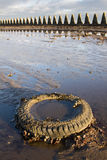 Discarded Tyre On Beach Royalty Free Stock Images