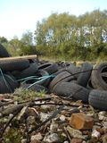 Discarded Tyres amongst Rubble Royalty Free Stock Photo