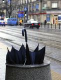 Discarded umbrella on the street stock photography